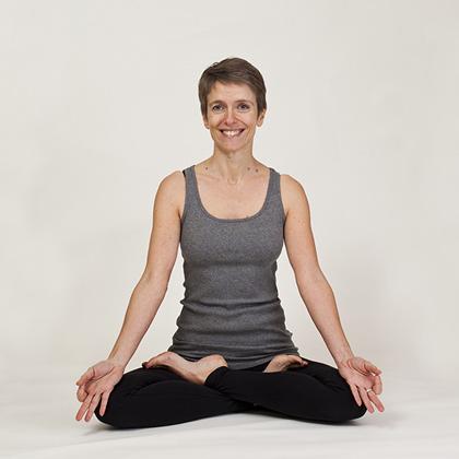 Kim in seated yoga pose - Lotus